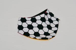 Halstuch Stoff Vorderseite: Jersey Fussball weiß/schwar Stoff Rückseite: Jersey Schwarz/rot/gelb Klettverschluss