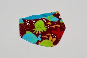 Halstuch Stoff Vorderseite: Jersey Seetiere braun Stoff Rückseite: Jersey uni türkis Klettverschluss